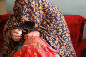 Covered Woman Sewing
